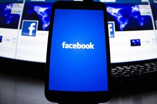 File photo of the loading screen of the Facebook application on a mobile phone in this photo illustration taken in Lavigny